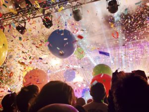 Confetti and giant balloons on the first song